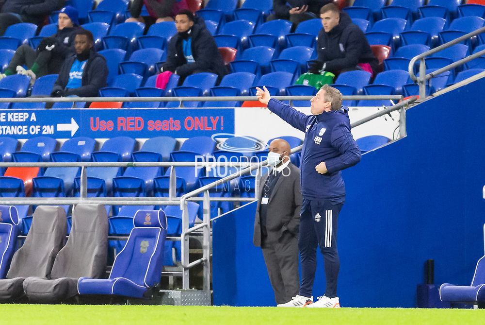 Cardiff City's First Team Manager Neil Harris shouts instructions to his team from the dug-out during the EFL Sky Bet Championship match between Cardiff City and Birmingham City at the Cardiff City Stadium, Cardiff, Wales on 16 December 2020.