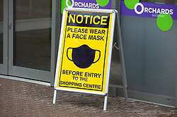 © Licensed to London News Pictures 16/02/2021.        Dartford, UK. A face mask sign in Dartford town centre in Kent today during a third national coronavirus lockdown. Non-essential shops could open in weeks if the Covid-19 infection rate keeps dropping. Photo credit:Grant Falvey/LNP