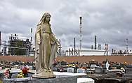 """The Holy Rosary Cemetery next to Dow Chemical (formally Union Carbide Complex) in Taft Louisiana is located across from the Mississippi River in the stretch between Baton Rouge and New Orleans, is part of a large concentration of chemical and oil companies that was formerly referred to as the """"Petrochemical Corridor,"""" by some and  """"Cancer Alley,"""" by others."""