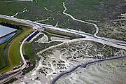 Nederland, Zeeland, Oosterschelde, 12-06-2009; Verdronken land van Zuid-Beveland, onderdeel van de Oosterschelde. Rond de strekdam het vroegere haventje van Rattekaai, met vergane steigers, rijksmonument. De zeedijk wordt verbeterd en voorzien van nieuwe bekleding, links van de dijk kassen. Swart collectie, luchtfoto (25 procent toeslag); Swart Collection, aerial photo (additional fee required).foto Siebe Swart / photo Siebe Swart