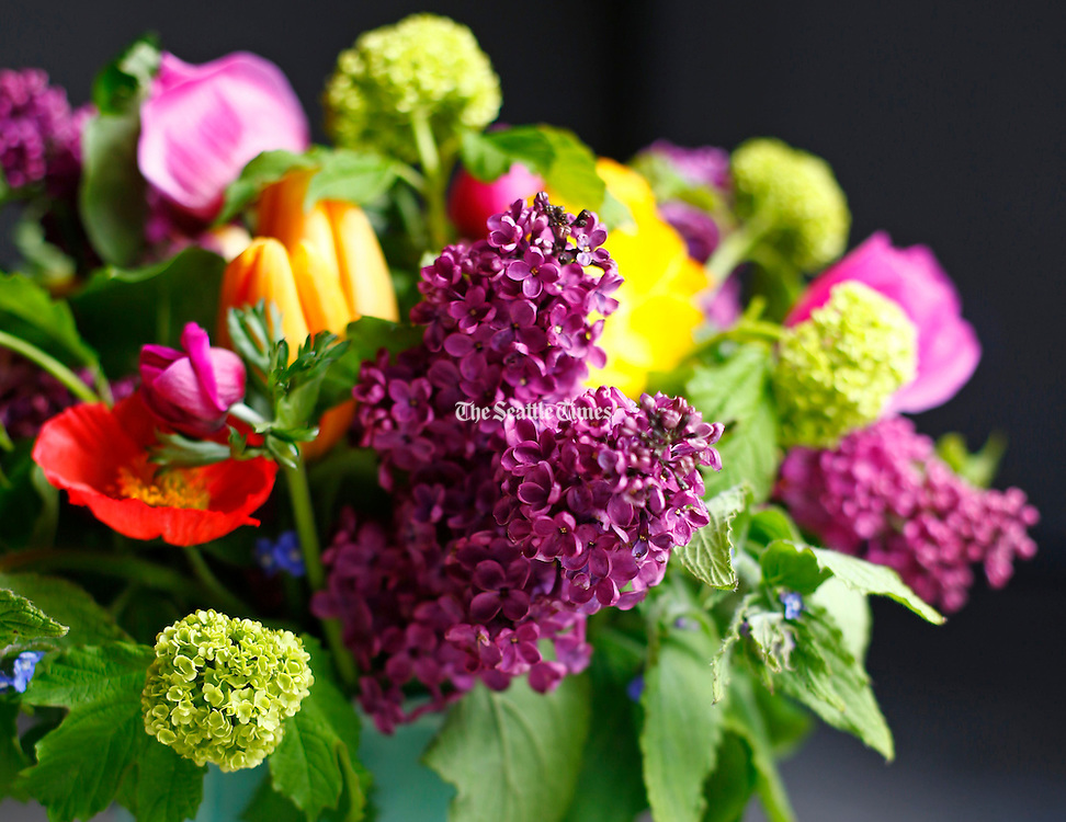 A bouquet of lilac, tulips, poppies, anemones, snowball viburnums and alkanets. (John Lok / The Seattle Times)
