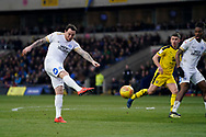 Lee Tomlin of Peterborough United shoots during the EFL Sky Bet League 1 match between Oxford United and Peterborough United at the Kassam Stadium, Oxford, England on 16 February 2019.