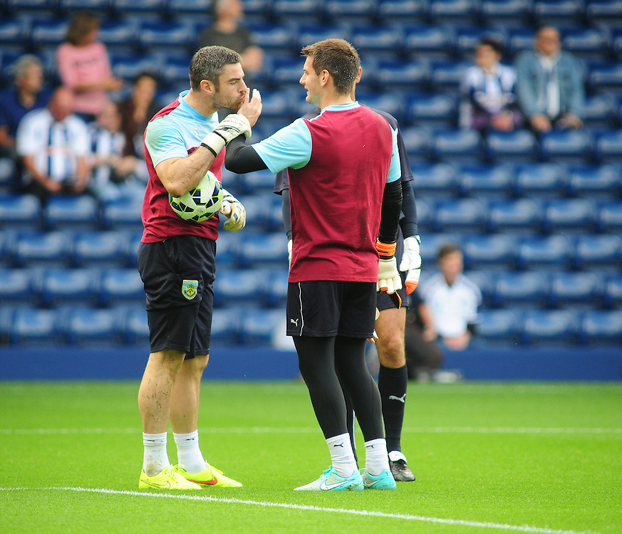 Burnley's Matthew Gilks, left, appears to kiss team-mate Thomas Heaton's little finger on his left hand during the pre-match warm-up <br /> <br /> Photographer Chris Vaughan/CameraSport<br /> <br /> Football - Barclays Premiership - West Bromwich Albion v Burnley - Sunday 28th September 2014 - The Hawthorns - West Bromwich<br /> <br /> © CameraSport - 43 Linden Ave. Countesthorpe. Leicester. England. LE8 5PG - Tel: +44 (0) 116 277 4147 - admin@camerasport.com - www.camerasport.com