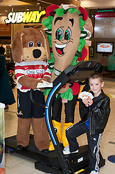 Subway Healthier Way Subs. Donny Dog the Doncaster Rovers Mascott and Subman with local lad at the Doncaster Subway.28 October 2010 .Images © Paul David Drabble