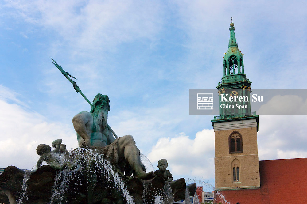 Statue of Neptune with St. Mary's Church, Berlin, Germany