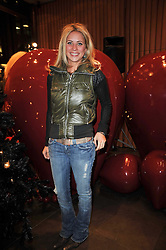 HOLLY BRANSON at a party to celebrate the launch of the new Mulberry leather case for Apple's iPhone held at the Mulberry store, Bond Street, London on 5th November 2009.