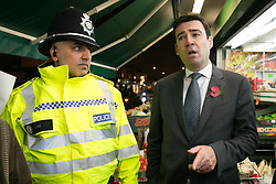 © Licensed to London News Pictures. 03/11/2015. Alum Rock, Birmingham, UK. Shadow Home Secretary ANDY BURNHAM visiting Alum Rock in Birmingham to launch the Labour Policy on Policing. Pictured, ANDY BURNHAM, right, talking to Sgt IFTI ALI on the Alum Rock Road. Photo credit : Dave Warren/LNP