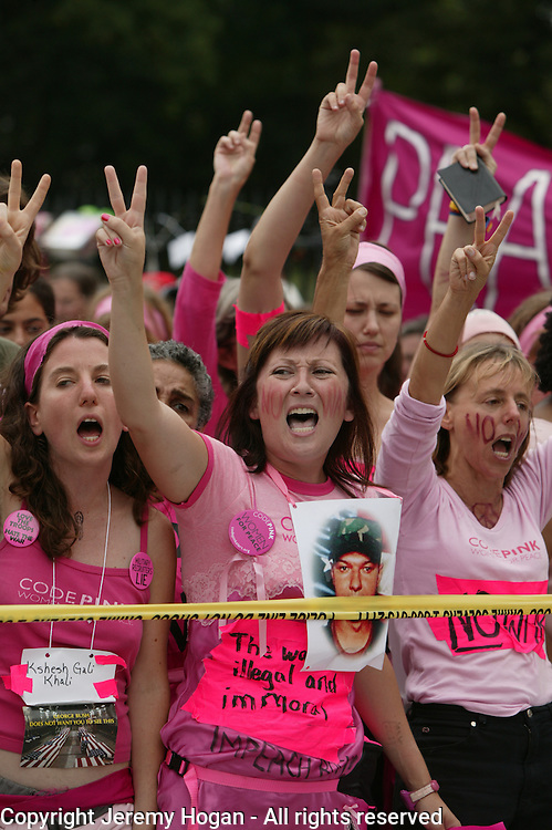 A member of Code Pink wears an image of Casey Sheehan while protesting at the Whitehouse against the war in Iraq.
