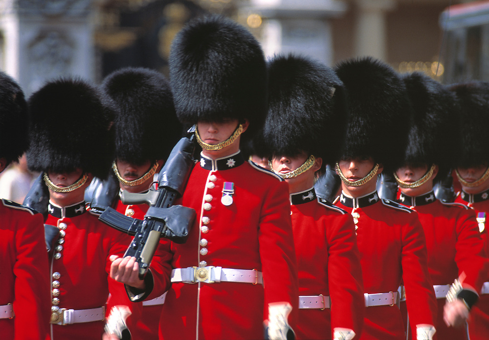 Queen's Guard marches to Buckingham Palace in London, England.
