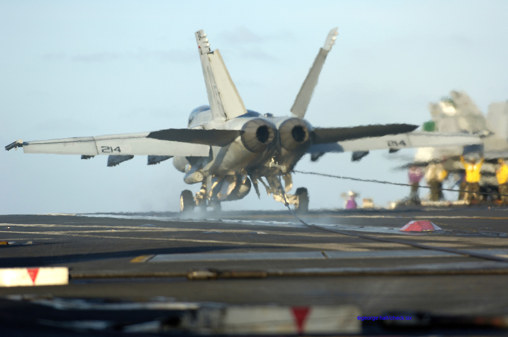 F-18 Hornet catches the wire.