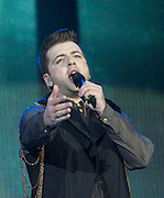 """Westlife Farewell Tour 2012 at the SECC.27-05-12...Mark Feehily of Irish Super Group Westlife perform during their sell out show at the SECC in the Scottish Leg of their Farewell World Tour. ..Westlife are an Irish boy band formed in 1998. They are to disband in 2012 after their farewell tour. The group's line-up was Shane Filan, Mark Feehily, Kian Egan, and Nicky Byrne. Brian McFadden was part of the group until 2004. Westlife have sold over 45 million records worldwide which includes studio albums, singles, video release, and compilation albums.. Despite the group's worldwide success, they only have one hit single in the United States, """"Swear It Again"""", which peaked in 2000 on the Billboard Hot 100 at number 20. The band were originally signed by Simon Cowell and are managed by Louis Walsh. The group have accumulated 14 number-one singles in the United Kingdom, the third-highest in UK history, tying with Cliff Richard..The group had also broken a few records, including """"Music artist with most consecutive number 1's in the UK"""", which consists of their first seven singles and only behind The Beatles and Elvis Presley..The band have 14 UK number ones and 25 top ten singles, consisting of 20.2 million records and videos in the UK across their 14-year career - 6.8 million singles, 11.9 million albums and 1.5 million videos. The Band are best known for amazing songs such as Flying Without Wings and Safe....At The SECC, Glasgow..Picture  Mark Davison/ ProLens PhotoAgency/ PLPA.Sunday 27th May 2012."""