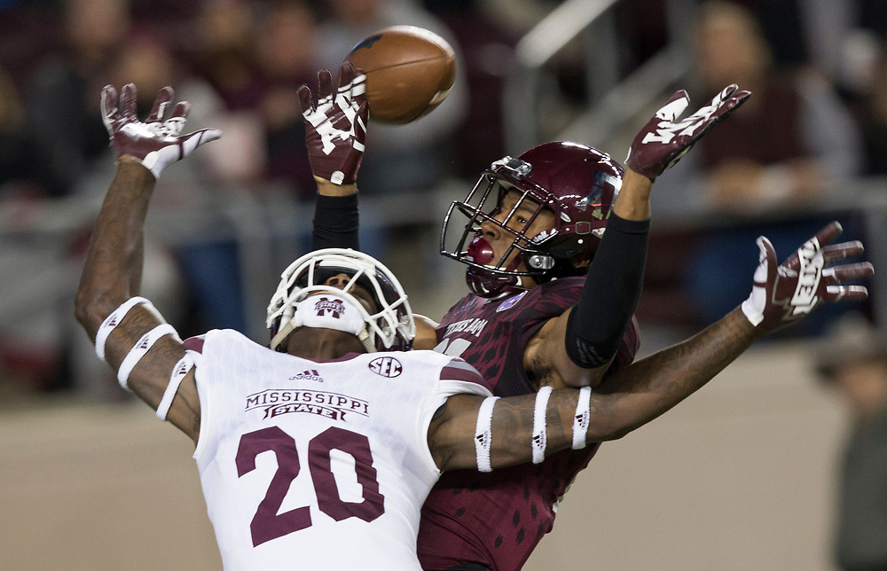 Texas A&M defensive back Charles Oliver (21) breaks up a pass intended for Mississippi State wide receiver Reginald Todd (20) in the end zone during the third quarter of an NCAA college football game on Saturday, Oct. 28, 2017, in College Station, Texas. Oliver was called for pass interference on the play (AP Photo/Sam Craft)