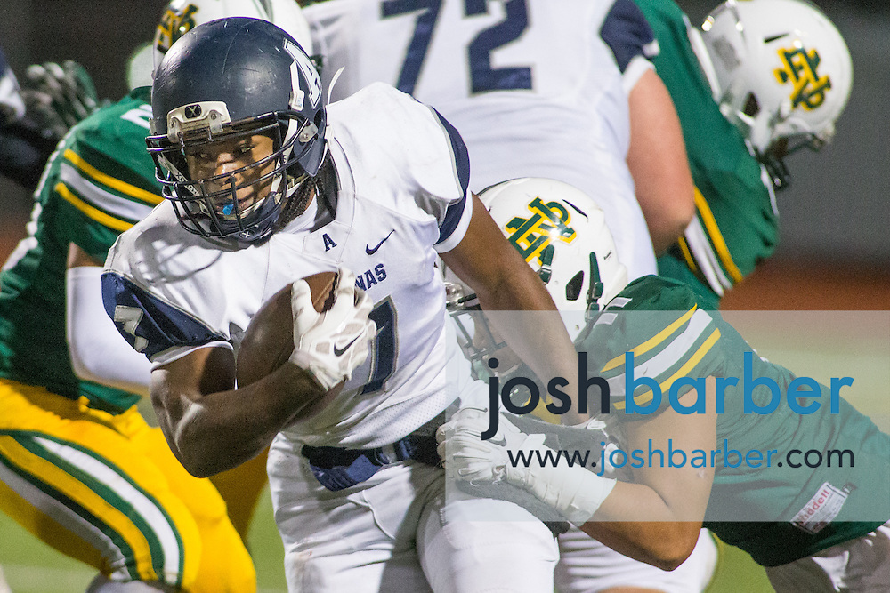 Aquinas' Branden Rankins, Notre Dame's Lawrence Mai during the CIF-SS Boys Football Northwest Division Semifinal at J.W. North High School on Friday, November 27, 2015 in Riverside, California. (Photo/Josh Barber)