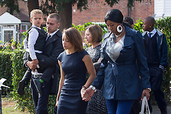 © licensed to London News Pictures. London, UK 27/09/2013. Mourners arriving Sabrina Moss's funeral at St Alphage Church in Burnt Oak, north London on Friday, 27 September 2013. Nursery teacher Sabrina Moss was shot dead in Kilburn while out celebrating her 24th birthday on Saturday 24 August 2013. Photo credit: Tolga Akmen/LNP