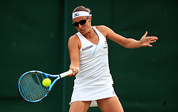 Kirsten Flipkens in action on day one of the Wimbledon Championships at the All England Lawn Tennis and Croquet Club, Wimbledon.