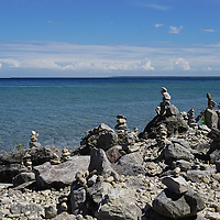 """""""Cairn on Mackinac Island"""" <br /> <br /> Imagine summertime on Mackinac Island! Gazing out at the blue waters of lake Huron, riding a bike along the shore, and seeing cairn all along the shoreline!"""