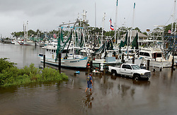 June 21, 2017 - Ocean Springs, Mississippi, U.S. - KENNY KULUZ wades through flood waters at the Ocean Springs harbor as Tropical Storm Cindy dumped rain on the Mississippi Gulf Coast on Wednesday. (Credit Image: © Tim Isbell/TNS via ZUMA Wire)