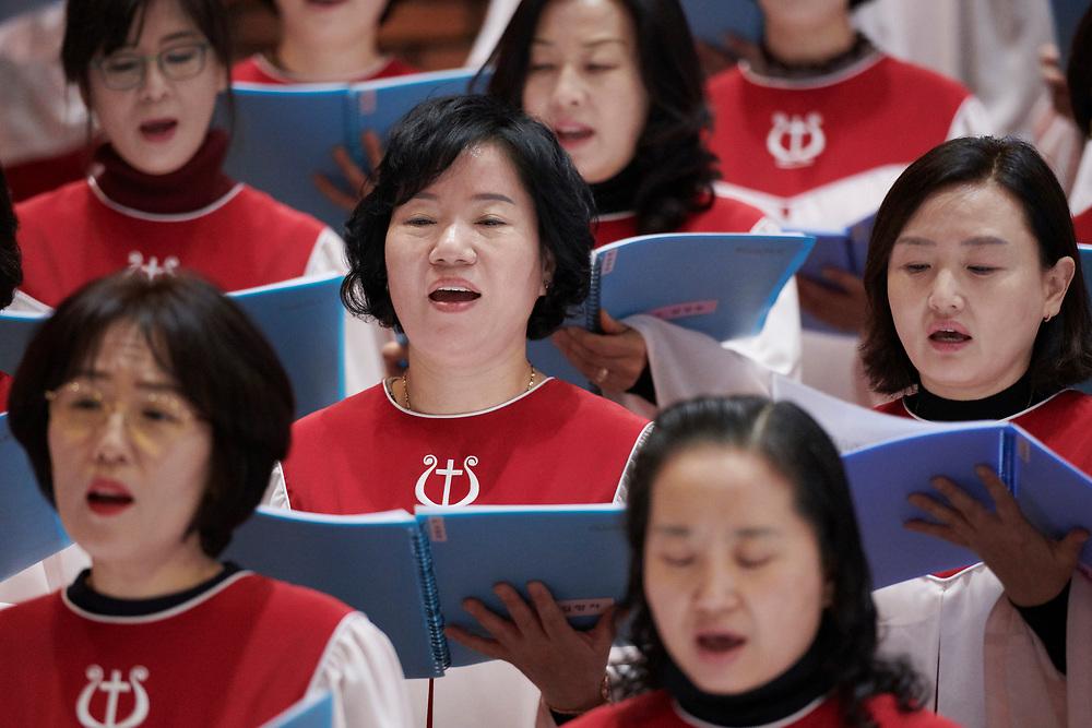 Choir members sing during a December 10, 2017, worship celebration in the Yum-kwang Presbyterian Church in Seoul, South Korea.