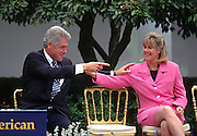 US President Bill Clinton jokes with Tipper Gore during an event at the White House March 22, 1997 in Washington, DC.