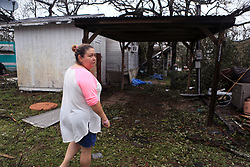 August 28, 2017 - Fulton, Texas, U.S. - DARLENE VASQUEZ returned to what was going to be a retirement home to survey the damage on Monday, near Bronte Street. She said she had been unable to find information so she and her husband decided to come check out the trailer and her mother's trailer themselves. (Credit Image: © Rachel Denny Clow/TNS via ZUMA Wire)