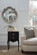 Interior design vignette of a hand crafted  end table and custom designed sofa