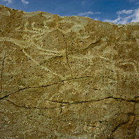 Sythian era petroglyphs in northern Mongolia's Darhad Valley probably date at least 2700 years before present.  The deer drawings very closely match carvings on distant Deer Stones.