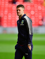 Burnley's Johann Berg Gudmundsson inspects the pitch before the game