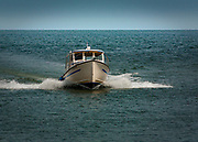A fishing boat speeds through the water.