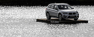 BMW X1 on a raft in the pond in full reflection from the late evening sunshine during Round One of the 2015 Alstom Open de France, played at Le Golf National, Saint-Quentin-En-Yvelines, Paris, France. /02/07/2015/. Picture: Golffile | David Lloyd<br /> <br /> All photos usage must carry mandatory copyright credit (© Golffile | David Lloyd)