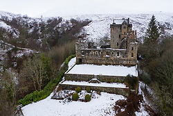 Dollar, Scotland, UK. 4 February 2021. Drone images of medieval Castle Campbell covered in Snow in hills above Dollar in Clackmannanshire, central Scotland.  Iain Masterton/Alamy Live News