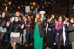 London, November 26th 2014. A vigil for teenager Mike Brown who was shot dead by a policeman in Ferguson, Missouri this year, takes place outside the US embassy in London. Anti-racism and human rights campaigners called the 'emergency' protest following a court verdict that clears Police Officer Darren Wilson of murder. PICTURED: Protesters march through Oxford Circus as the rain begins to fall.