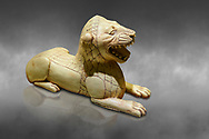 Phrygian ivory statuette carved as a roaring lion lying down from a table base decoration. From Gordion. Phrygian Collection, 8th-7th century BC - Museum of Anatolian Civilisations Ankara. Turkey. Against a grey background .<br /> <br /> If you prefer you can also buy from our ALAMY PHOTO LIBRARY  Collection visit : https://www.alamy.com/portfolio/paul-williams-funkystock/phrygian-antiquities.html  - Type into the LOWER SEARCH WITHIN GALLERY box to refine search by adding background colour, place, museum etc<br /> <br /> Visit our CLASSICAL WORLD PHOTO COLLECTIONS for more photos to download or buy as wall art prints https://funkystock.photoshelter.com/gallery-collection/Classical-Era-Historic-Sites-Archaeological-Sites-Pictures-Images/C0000g4bSGiDL9rw