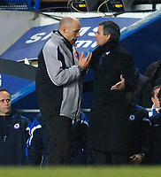 Photo: Daniel Hambury.<br />Chelsea v Liverpool. The Barclays Premiership. 05/02/2006.<br />Chelsea's manager Jose Mourinho questions the fourth official, Howard Webb.