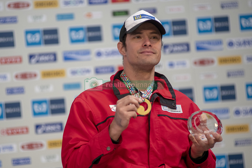 March 3, 2019 - Tokyo, Tokyo, Japan - Hug Marcel (SUI) holds up the winner's trophy during the awards ceremony following his victory in the wheelchair race of the Tokyo Marathon 2019 in Tokyo, Japan, March 3, 2019. Some 38,000 runners participated in the thirteenth edition of the Tokyo Marathon, one of the six World Marathon Majors. (Credit Image: © Alessandro Di Ciommo/NurPhoto via ZUMA Press)