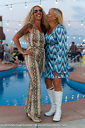 Heather Callen and Missi Shoemaker at Cycle Source Magazine's 70's pool party at the Steel Pony Campground during the Sturgis Motorcycle Rally. SD, USA. Thursday, August 12, 2021. Photography ©2021 Michael Lichter.