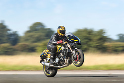 © Licensed to London News Pictures. 19/09/2015. York, UK. Picture shows Gary Rothwell performing his World Record breaking 200MPH wheelie at the Starightliners speed weekend that has taken place at Elvington Airfield near York today were a motorised shed, Jet car & motorbikes attempt new British speed records. Photo credit: Andrew McCaren/LNP