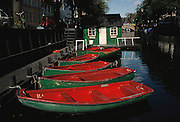 Christianshavn Canal with red and green rowboats for rent. Copenhagen, Denmark.