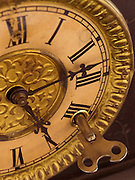 an old to windup clock with key