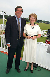 MR & MRS HUGH BRETT  at the Queen's Cup polo final sponsored by Cartier at Guards Polo Club, Smith's Lawn, Windsor Great Park on 18th June 2006.  The Final was between Dubai and the Broncos polo teams with Dubai winning.<br /><br />NON EXCLUSIVE - WORLD RIGHTS