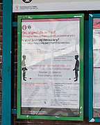 MERTHYR TYDFIL, Wales- 13 MAY 2020: Signs displayed at Merthyr train station telling people to social distance and information on the corona virus regarding travel.