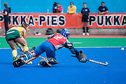 Dirkie Chamberlain of South Africa beats Italy's Sara Sorial in the penalty shoot out during their match in the Investec Hockey World League Semi Final 2013, Quintin Hogg Memorial Sports Ground, University of Westminster, London, UK on 29 June 2013. Photo: Simon Parker