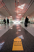 Departures sign inside Terminal Three of Beijing Capital International Airport, China