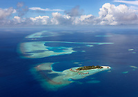 Aerial view of an isolated resort island, Maldives.