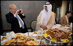 The London Mayor Boris Johnson takes a picture with his phone of his lunch a Camel Dish as he gets H.H Sheikh Nahyan bin Mubarak Al Nahyan, Minister of Culture and Youth to pose by the dish in Adu Dhabi. The Mayor is on a 2 day tour of the UAE, Monday April 15, 2013. Photo By Andrew Parsons / i-Images