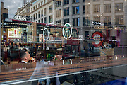 A shop employee applies make-up from a brush in the window of a House of Fraser store in the Square Mile, on 31st March 2017, in the City of London, England. House of Fraser is a British department store group with over 60 stores across the United Kingdom and Ireland. It was established in Glasgow, Scotland in 1849 as Arthur and Fraser. By 1891, it was known as Fraser & Sons.