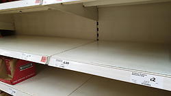 © Licensed to London News Pictures. 23/07/2021. London, UK. Empty shelves in a Sainsbury's store in London. The government has announced that daily contact testing will be rolled out to workplaces in the food sector, so staff who have been pinged by the COVID-19 app can keep working if they test negative rather than isolating. This is because a number of supermarkets are reporting empty shelves as they, wholesalers and hauliers are struggling to ensure enough food and fuel supplies, after the COVID-19 NHS app alerted workers to isolate after being in contact with someone with COVID-19. Photo credit: Dinendra Haria/LNP