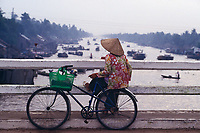 """Woman on the bridge at Phung Hiep, Mekong Delta, Vietnam<br /> Available as Fine Art Print in the following sizes:<br /> 08""""x12""""US$   100.00<br /> 10""""x15""""US$ 150.00<br /> 12""""x18""""US$ 200.00<br /> 16""""x24""""US$ 300.00<br /> 20""""x30""""US$ 500.00"""
