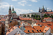 """View from a tower at the end of Charles Bridge to Mostecka street and the """"Lesser Town"""" (Mala Strana). In the back the Church of Saint Nicolas (left) and Prague Castle."""