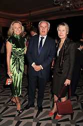 Left to right, LORD & LADY MYNERS and BARONESS VIRGINIA BOTTOMLEY at the annual Veuve Clicquot Business Woman of the Year Award this year celebrating it's 40th year, held at Claridge's, Brook Street, London on 18th April 2012.