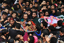 June 21, 2017 - Srinagar, Jammu and Kashmir, India - Kashmiri Villager Shouting slogans during the funeral  procession of slain militants Gulzar Ahmad Lone. Gulzar of Brathkalan who got killed along with his associate Basit Ahmad in a gunfight at seloo area in Sopore some 55 kilometers away from Srinagar the summer capital of Indian-controlled Kashmir on Wednesday morning. (Credit Image: © Eeshan Peer/Pacific Press via ZUMA Wire)